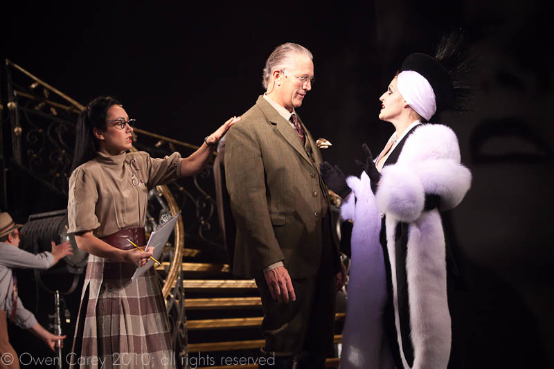 Tracy as Heather, Cecil B. DeMille's assistant, standing with the director and Norma Desmond