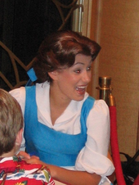Signing autographs as 'peasant Belle.'